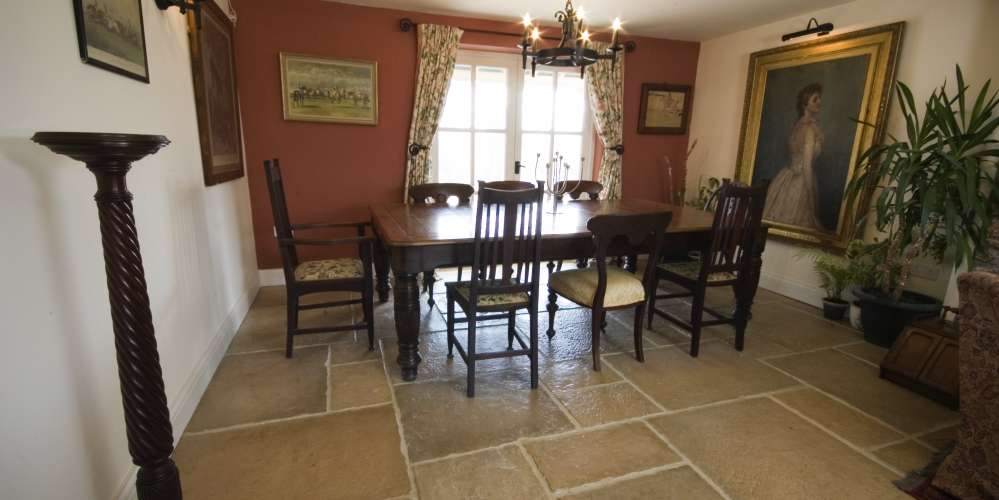Traditional dining room stone floor